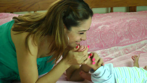 happy young hispanic mother kissing her two months Footage