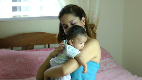 Hispanic Latina mother holding drooling baby over Stock Video Footage