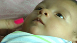 Close Up Of An Infant Smiling stock footage