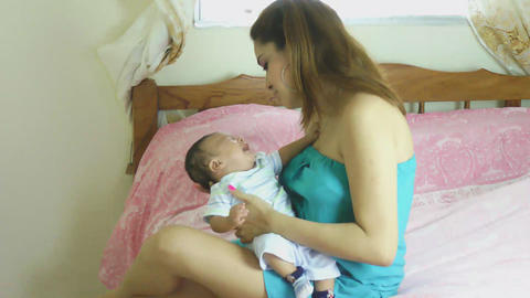 Mother holding her crying baby Stock Video Footage