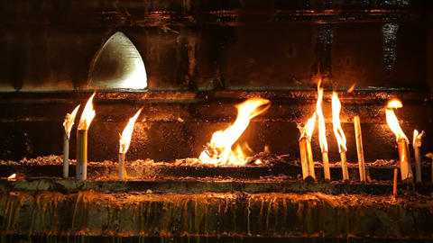 Candles burning in buddhist temple Stock Video Footage