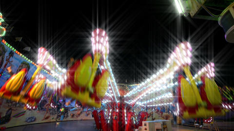 funfair carousel jumping with dreamy look Stock Video Footage
