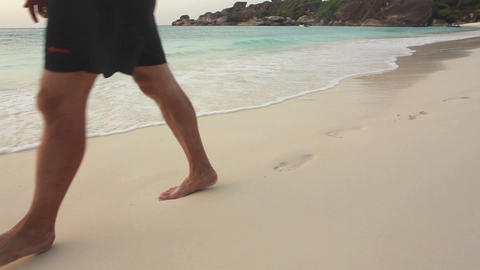 Man walking on sand beach Stock Video Footage