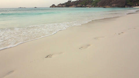Man walking on sand beach Stock Video Footage