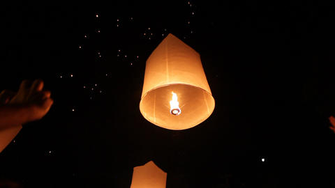 Launching flying lantern Stock Video Footage