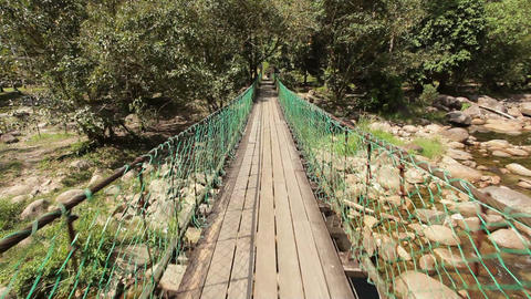 Crossing jungle bridge Footage