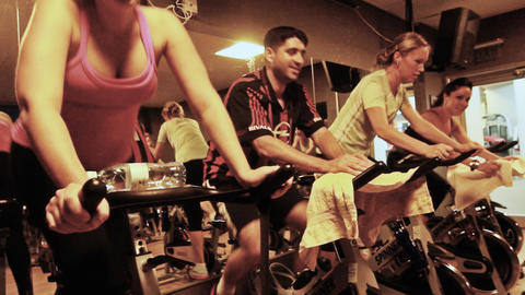 Spinning class workout wellbeing Woman doing fitne Stock Video Footage