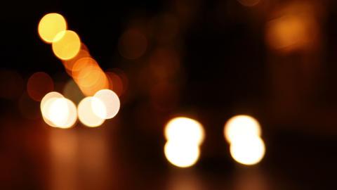 Night traffic. Defocused headlights. Seamless loop Footage