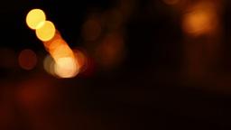Night traffic. Defocused headlights. Seamless loop Stock Video Footage