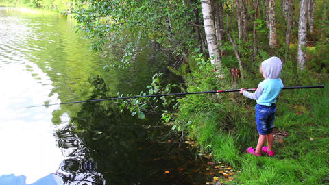 fishing littlle girl with rod on forest lake Footage