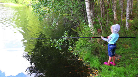 fishing littlle girl with rod on forest lake Stock Video Footage
