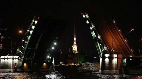 ship under open drawbridge at night in St. Petersb Stock Video Footage