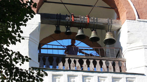 ringer playing on bells on church tower - Suzdal R Stock Video Footage
