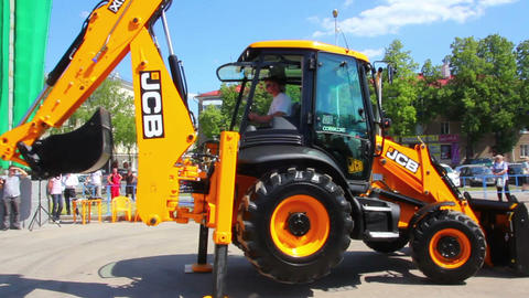 demonstration of multifunctional tractor at the ex Stock Video Footage