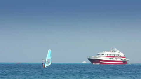 yachts and surfers on turquoise sea Stock Video Footage