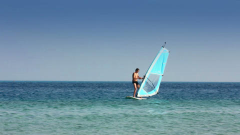windsurfing - man learns to ride on windsurfer Footage