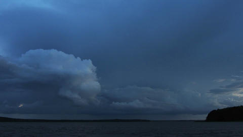 approaching storm on lake after sunset - timelapse Footage