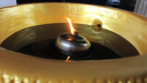 Flame Flickering In Buddhist Temple Stock Video Footage