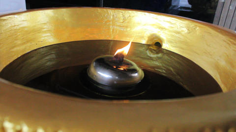 Flame Flickering In Buddhist Temple Footage