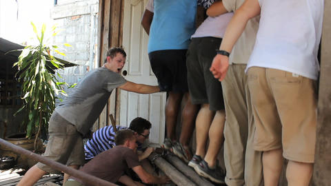 Young Missionaries Working Hard On Construction Jo Stock Video Footage