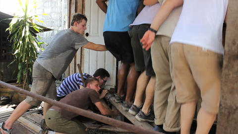 Young Missionaries Working Hard On Construction Jo stock footage