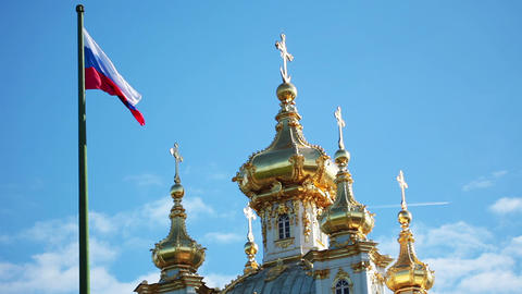 Domes of the church and Russian flag Stock Video Footage