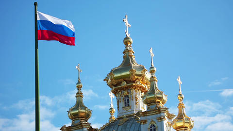 Domes of the church and Russian flag Footage