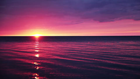 Sunset Over A Calm Ocean stock footage