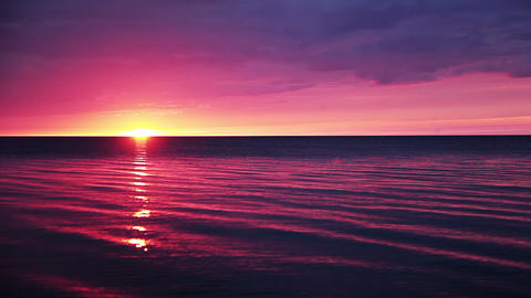 Sunset over a calm ocean Stock Video Footage