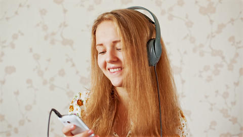 The girl listens to music Stock Video Footage