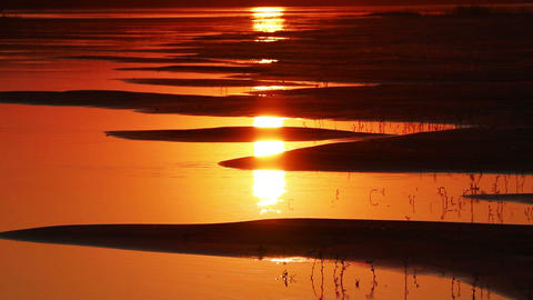 beautiful orange sunset with waved river sand beac Footage