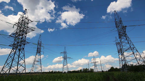 tall electric masts against cloudy sky - timelapse Footage