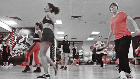 women losing weight exercising and dancing during Footage