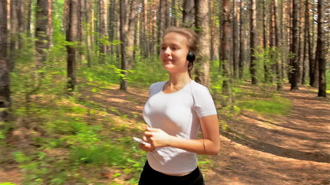 Jogging in wood Footage