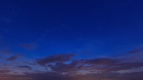 Sunset, then the stars and clouds. Time Lapse. 4K Stock Video Footage
