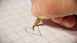 Hand Drawing A Heart On Paper Macro stock footage