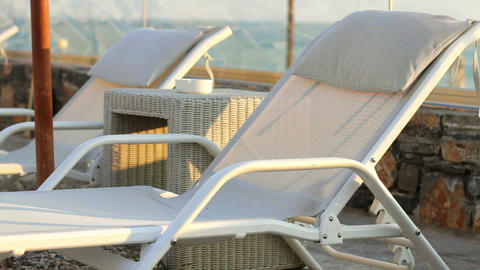 Sun beds by the sea. A peaceful holiday Stock Video Footage
