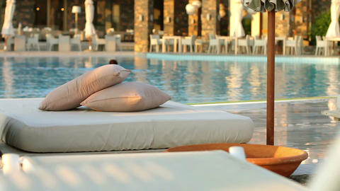 Beach loungers and floating in the pool, the woman Stock Video Footage