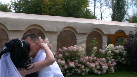 Glidecam: Bride and groom kiss Stock Video Footage