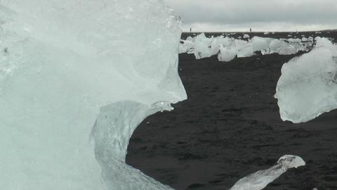 isolated iceberg on sand beach melting Stock Video Footage