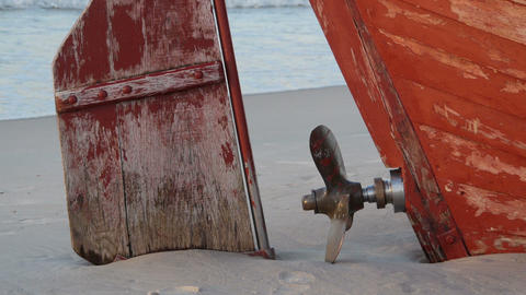 Old bolt and rudder on the beach Stock Video Footage