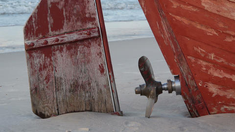 Old bolt and rudder on the beach ビデオ