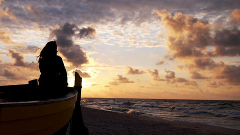 Woman on boat during sunset Stock Video Footage