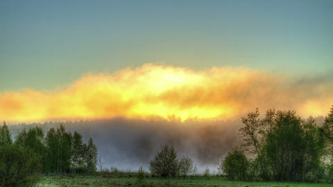 Sunrise through the mist. True HDR. Bright colors Stock Video Footage
