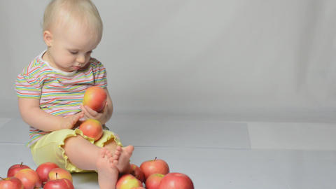 baby playing with apples Stock Video Footage