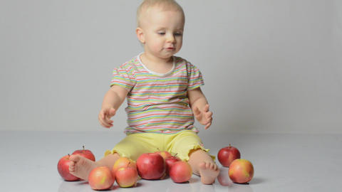 baby playing with apples Footage