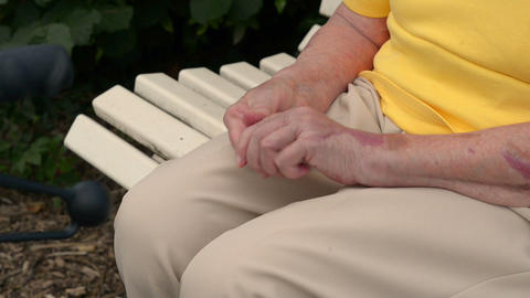 pensioner massaging her hands 11077 Stock Video Footage