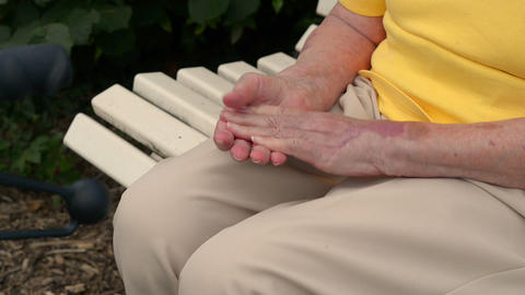 pensioner massaging her hands 11077 Footage