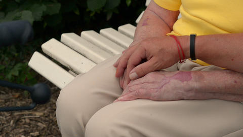 man hold and strokes pensioners hands 11083 Stock Video Footage