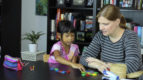Homeschool Mom Teaches A Math Lesson With Daughter Stock Video Footage